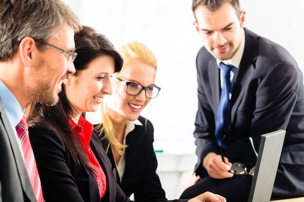 People in office working as team