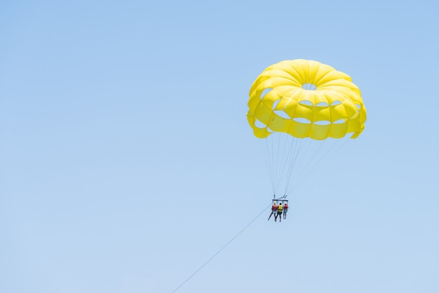People on parasailing in the sky