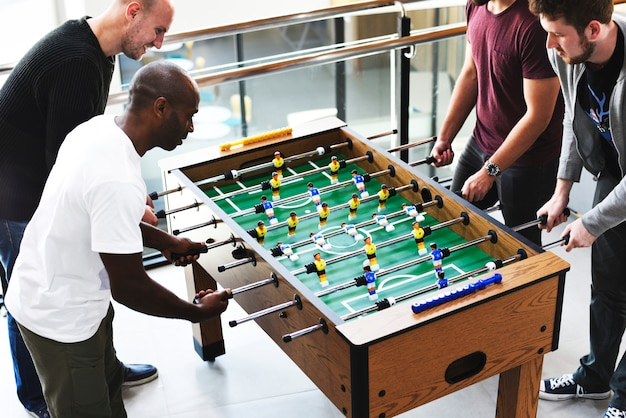 People playing enjoying foosball table soccer game recreation leisure