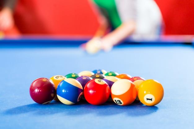 People playing pool billiard game
