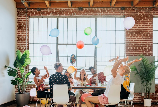 People playing with balloons at a party