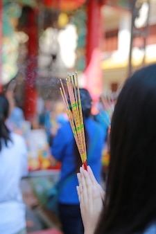 People pray respect with incense burning for god in chinese new year day.