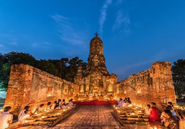 People praying respect to monk on ayutthaya