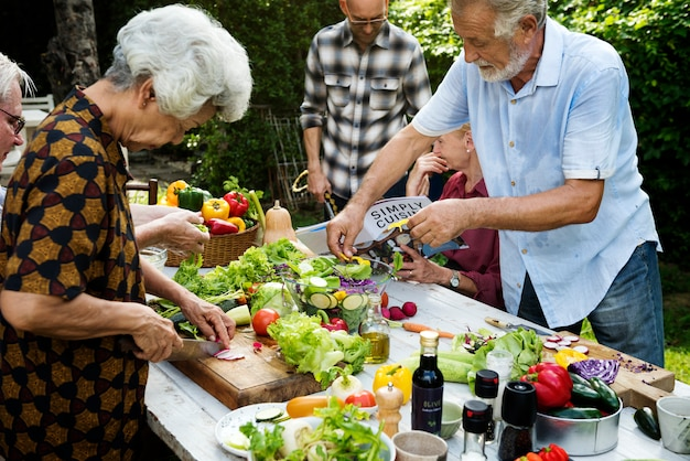 People prepare a vegetable for salad