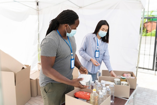 People preparing a charity foodbank for poor people
