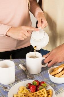 People preparing delicious breakfast