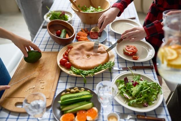 People preparing dinner close up