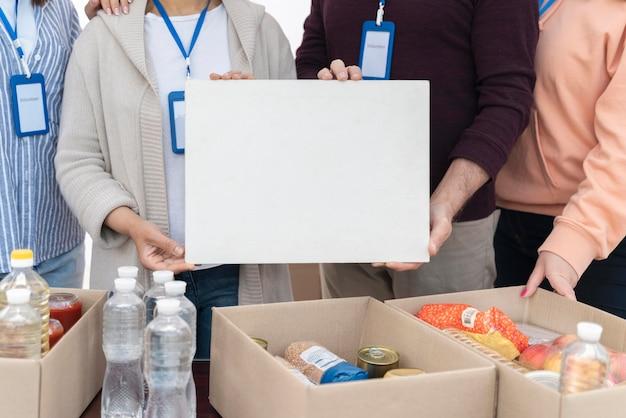 People preparing a foodbank for poor people