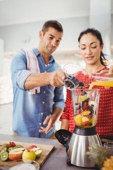 People preparing fruit juice