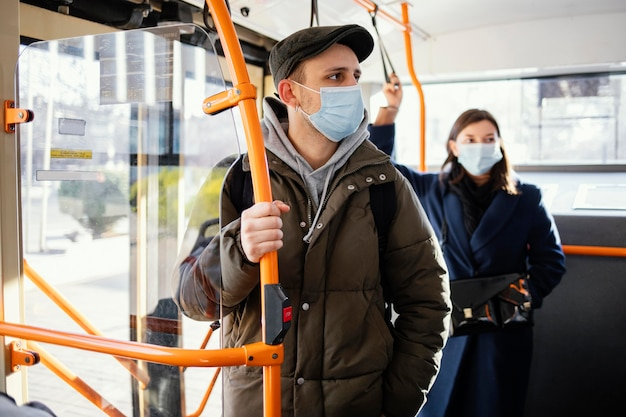 People in public transportation wearing mask