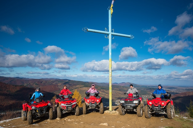 People on quad bikes on top of mountain