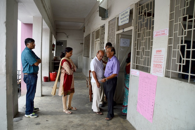 People queued in front of a polling station during election