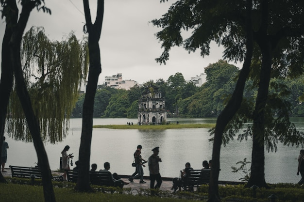 People relaxing in front of lake hanoi vietnam