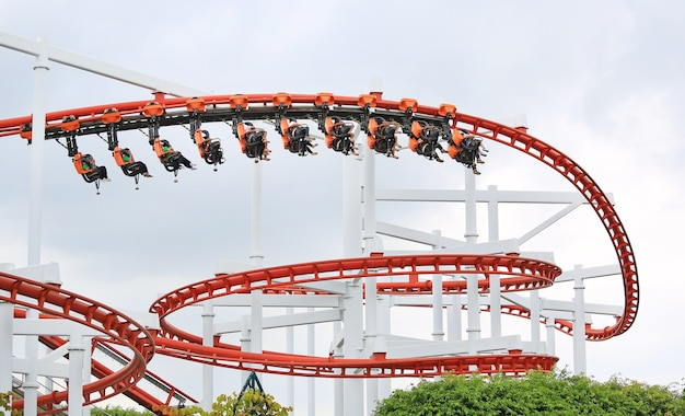 People ride on roller coaster