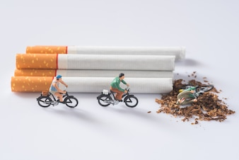 People riding a bike on cigarette background