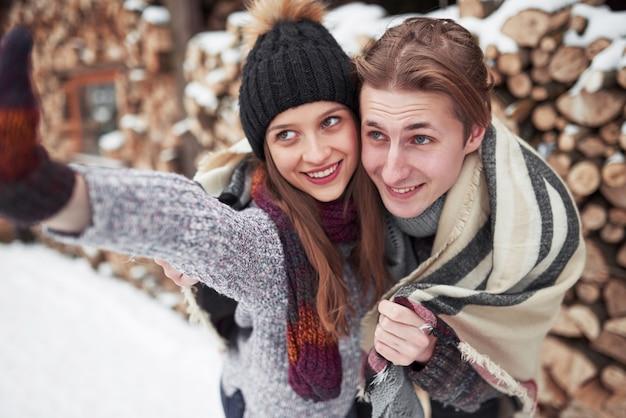 People, season, love and leisure  - happy couple having fun over winter