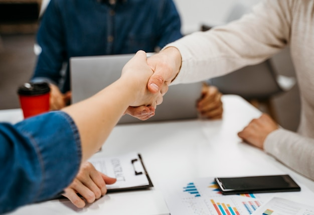 People shaking hands after a business discussion