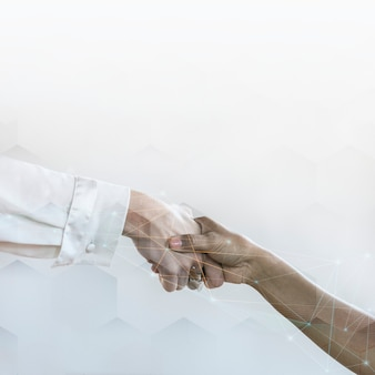 People shaking hands in business agreement background