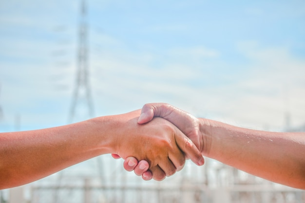 People shaking hands communicate the meaning of unity business cooperation success teamwork