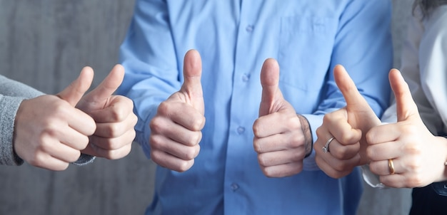 People showing thumb up gesture. success