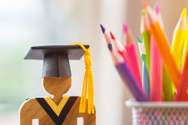 People sign wood with graduation celebrating cap blur pencil box