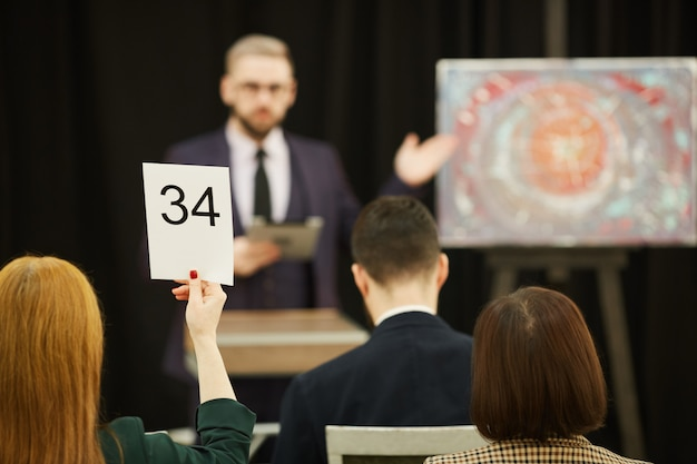 People sitting at auction
