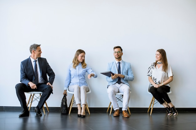 People sitting in the waiting room  before an interview
