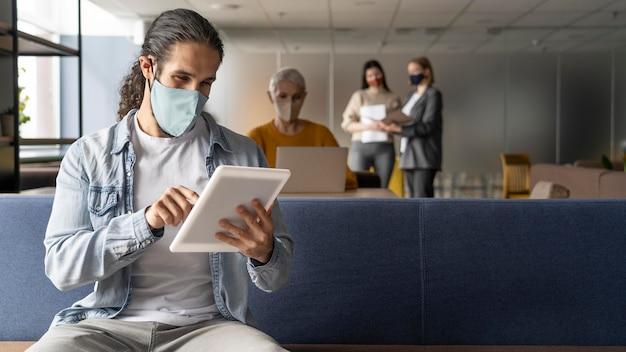 People social distancing at work