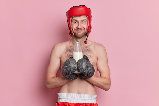 People sport healthy drink concept. cheerful boxer wears protective hat boxing gloves.