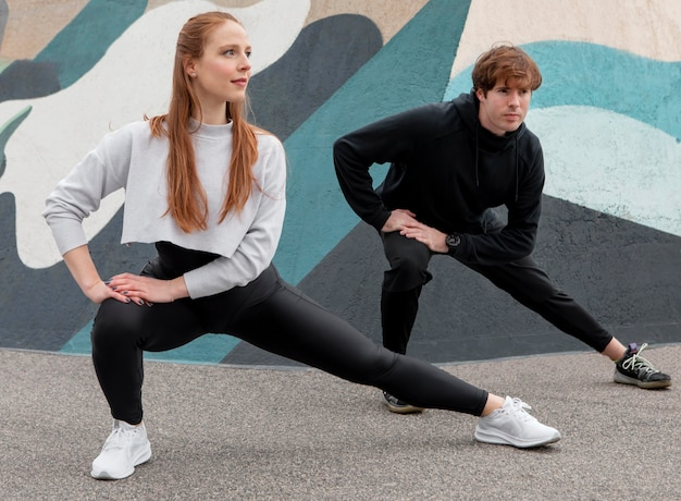 People in sportswear exercising outdoors