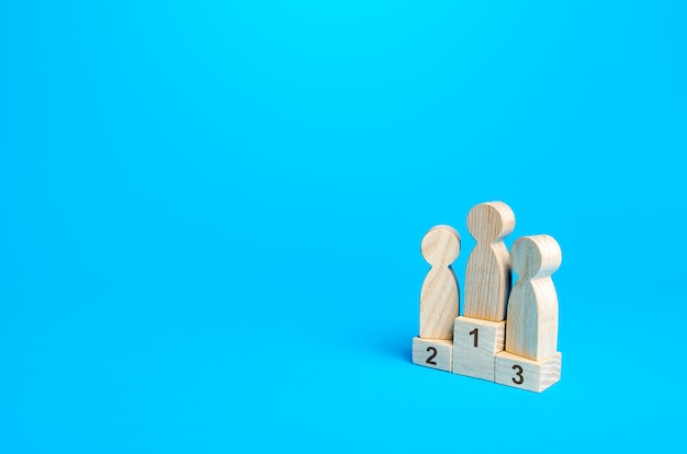 People stand on a sports awards podium first second and third place competition concept summing up
