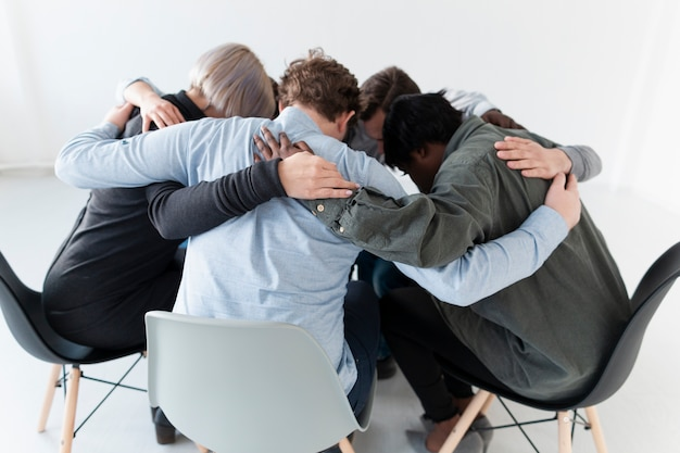 People standing on chairs and embracing
