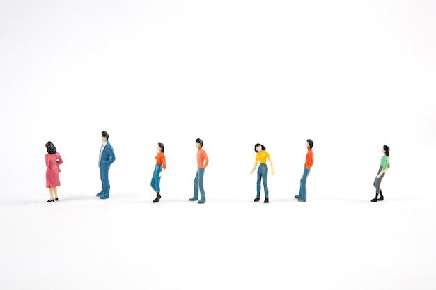 People standing in a line on white