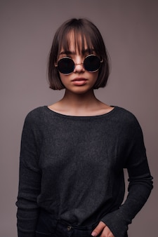 People, style and fashion concept - happy young woman or teen girl in casual clothes and sunglasses