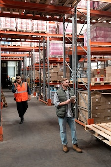 People taking care of warehouse logistics