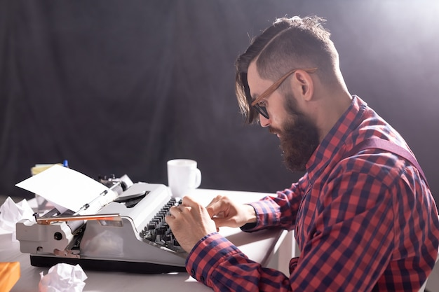 People and technology concept world day of the writer handsome man with glasses dressed in plaid