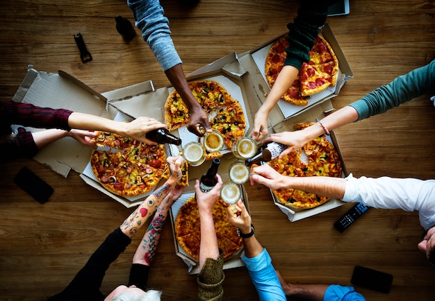People together eat pizza drink beers