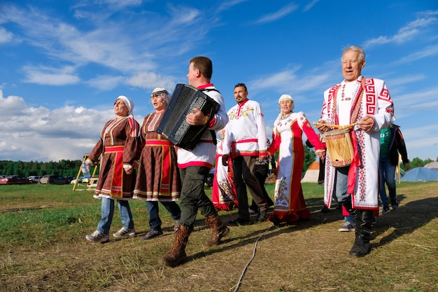 People in traditional costumes playing music