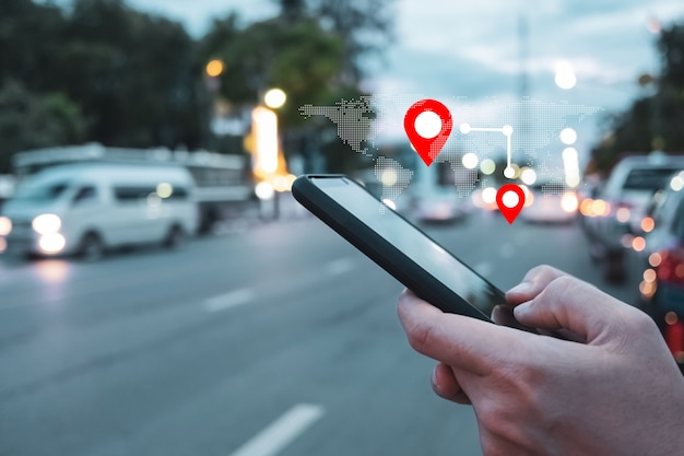 People use smartphone to check map to travel with internet and gps application for vacation.