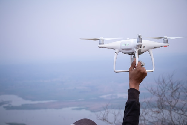 People using drone take photo with happy.