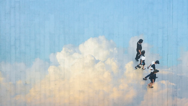 People walk on across the pedestrian concrete landscape with  reflect the cloud and blue sky.