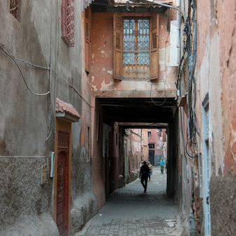 People walking in a narrow street, medina, marrakesh, morocco