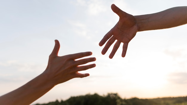 People wanting to take each other hands