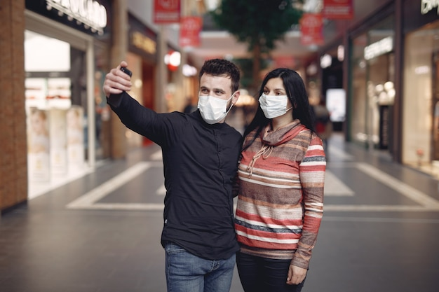 People wearing a protective mask taking a selfie