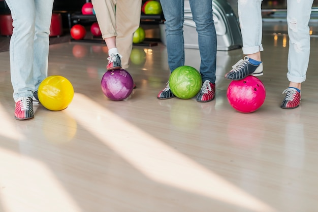 People with colorful bowling balls