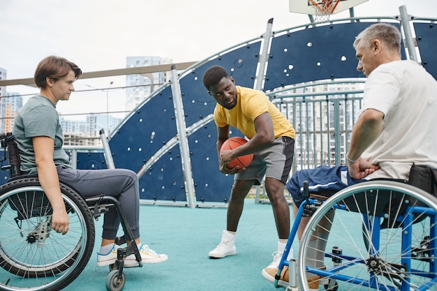 People with disability learning to play basketball