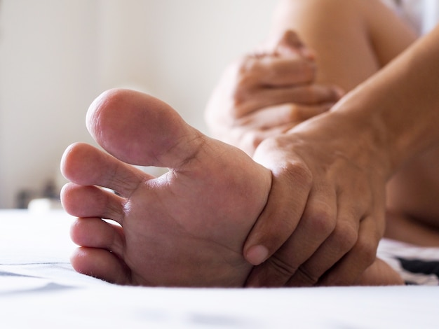People with sore feet with plantar fasciitis, foot inflammatory ligament disease