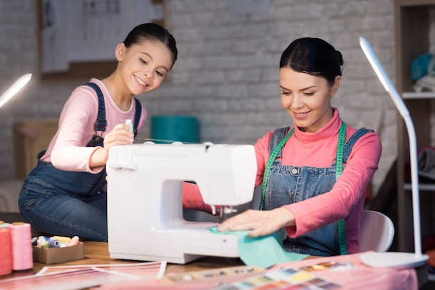 People working together on the creation of clothes