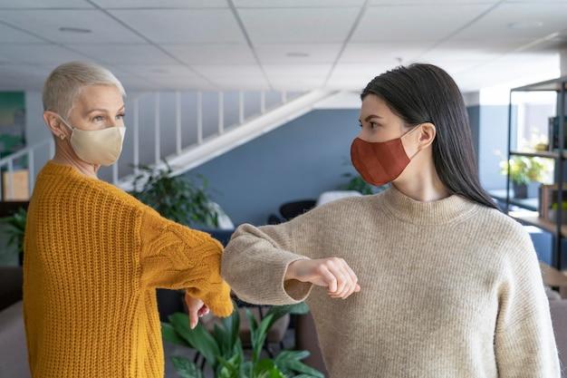 People in workspace social distancing