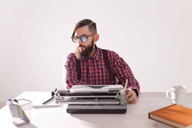 People, writer and hipster concept - young stylish writer working on typewriter.